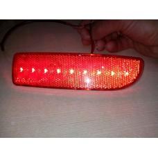 Световозвращатель на бампер Лада Приора левый светодиод